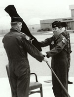 [Al Whitley handing over the furled 37th FW standard after the last F-117A departed TR for the last time. (USAF)]
