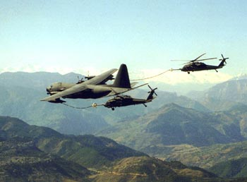 [MC-130 refueling two HH-60G Pave Hawks.()]