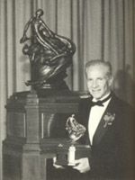 [Ben Rich with the F-117A Collier Trophy. (LMSW)]