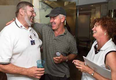 [Mike Powanda, left, greets Richard and Darlene New as they arrive Friday for the Stealth Fighter Association's 20th anniversary reunion at Caesars Palace. 