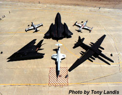 [The aircraft of the Skunk Works.  Clockwise A-12/YF-12/SR-71, F-80, U-2/TR-1, F-104, F-117A, T-33. (Photo by Tony Landis)]